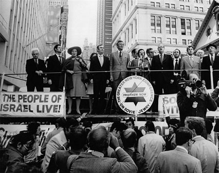 Sunday, October 14, 1973: At the Freedom Rally for Israel at City Hall in New York City.  Singing Hatikva, Israel's national anthem, are (left to right): Hon. Paul O'Dwyer; former Prisoner of Conscience Arkady Voloshin; Rep. Bella Abzug (D-NY); Mayor John V. Lindsay; Jo Amar; Greater New York Conference on Soviet Jewry Chairman Stanley H. Lowell; Israeli Foreign Minister Abba Eban; City Council president Sanford Garelick; Greater New York Conference on Soviet Jewry treasurer Samuel Hausman; American Zionist Federation president Rabbi Israel Miller.